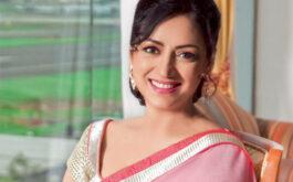 Anuradha Patel smiling for the camera
