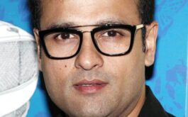 Rohit Roy wearing glasses and smiling at the camera
