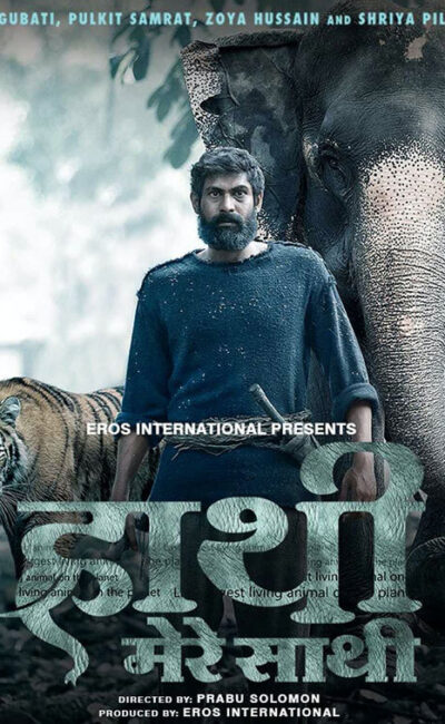 rana duggubati standing in front of an elephant